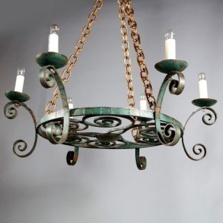 A French bronze patinated iron modernist crown chandelier