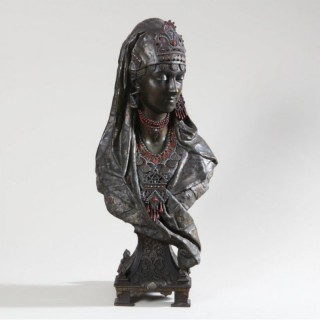 ORIENTALIST POLYCHROME SPELTER BUST OF A JEWELLED LADY