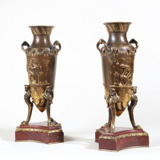 PAIR OF BRONZE VASES ON ROUGE GRIOTTE MARBLE BASES