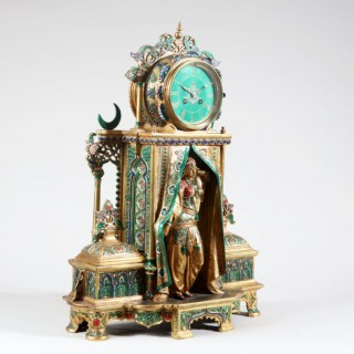 AN ORIENTALIST COLD PAINTED AND GILT BRONZE CLOCK