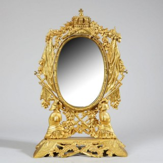 ORMOLU VANITY MIRROR WITH TROPHY AND ARMOUR MOTIFS