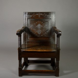 Carved 17th century oak arm-chair