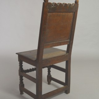 Panelled back oak chair