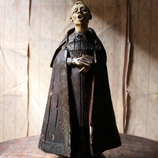 A 19thC Italian Painted Ceramic Figure of a Chanting Monk
