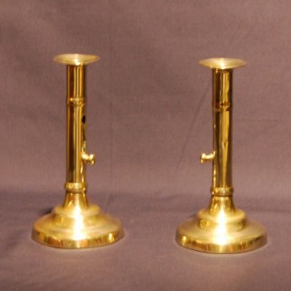 Pair of George III period Brass Ejector Candlesticks
