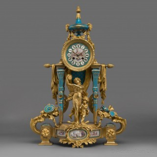 A Fine Gilt-Bronze and Sèvres Style Porcelain Mounted Figural Clock