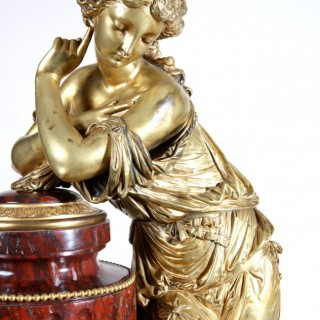 FRENCH ORMOLU MOUNTED ROUGE GRIOTTE MARBLE FIGURAL CLOCK GARNITURE