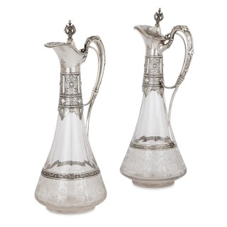 Two antique German repousse silver and crystal glass jugs