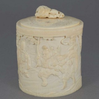 A FINELY CARVED JAPANESE IVORY LIDDED TRINKET BOX - LUCKY GODS