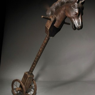 Very interesting original wooden carved hobby horse Rocking horse, with original wood and metal wheels.