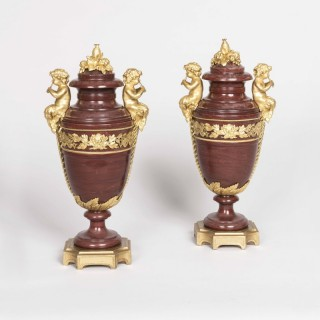 A Pair of Urns in the Louis XVI Manner attributed to Henry Dasson