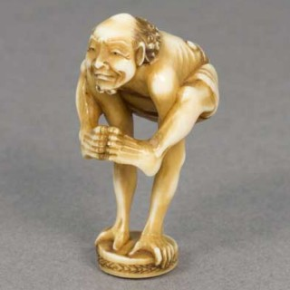 COMICAL JAPANESE IVORY NETSUKE OF ASHINAGA AS AN ACROBAT - GYOKUYOSAI