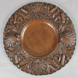 A magnificent, very fine hand chased copper charger,  Continental, 19th. century.