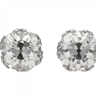 Old mine cushion shape diamond stud earrings, circa 1920.