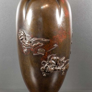 A HUMOROUS JAPANESE MEIJI PERIOD BRONZE VASE DEPICTING SHOKI CHASING ONI'S
