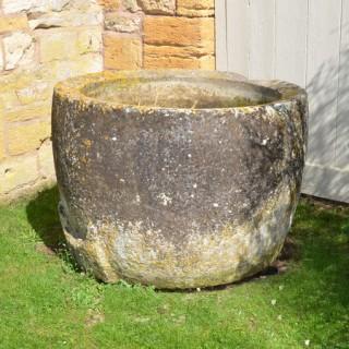An 18th century cicular stone trough