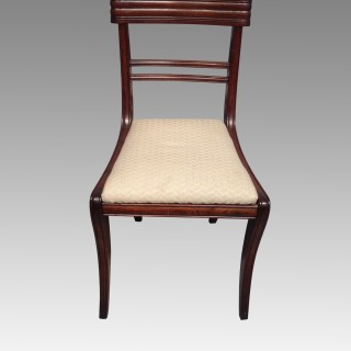 A set of six Regency mahogany dining chairs.