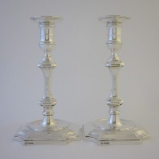 A pair of George V Sterling silver candlesticks