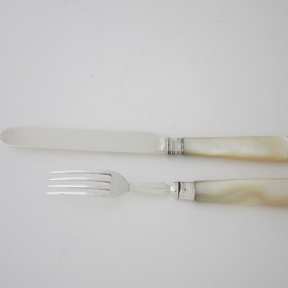 A set of twelve Sterling silver and pearl dessert knives and forks