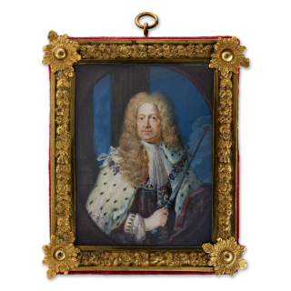Portrait miniature of King George I (1660-1727), wearing State Robes, a lace steinkirk cravat, Garter collar and George, column and sky background, painted spandrels c.1720