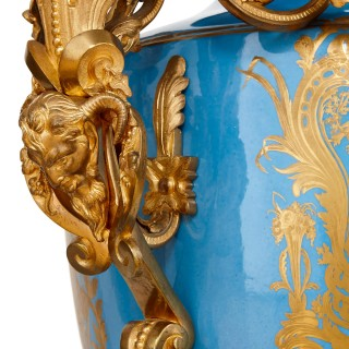 Monumental pair of gilt bronze mounted Sevres style porcelain vases