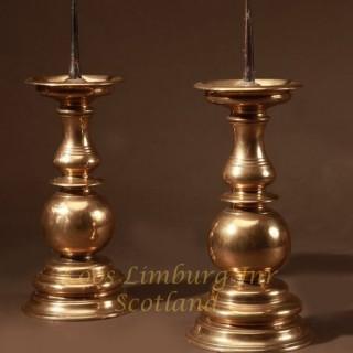 A large real pair of original Nurnberg brass candlesticks