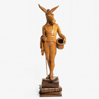 Italian walnut carving of a man with a donkey's head,