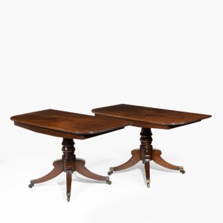 A rare and most unusual late George III  pair of mahogany console tables which convert into a twin pillar dining table