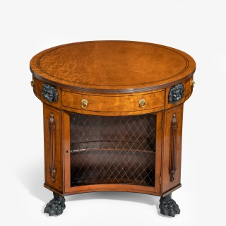 An unusual Regency plum-pudding mahogany library centre table and bookcase,