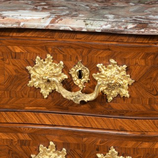 An imposing kingwood commode by de Jeune