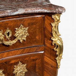 An imposing kingwood commode by de Jeune