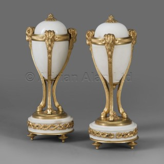 An Elegant Pair of Small Candlestick Garnitures