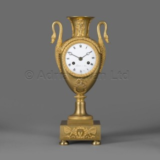 A Gilt-Bronze Empire Clock In The Form Of a Classical Urn