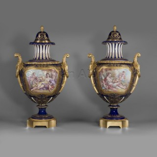 A Pair of Sèvres-Style Gilt-Bronze Mounted Porcelain Vases and Covers