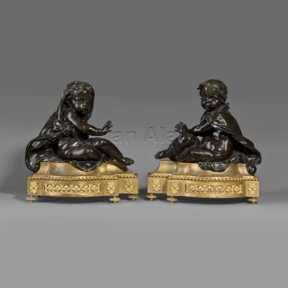 A Fine Pair of Louis XVI Style Chenets Allegorical of Winter