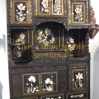 A Magnificent Oriental  Japanese Cabinet With 13 panels Including The Doors, Beautifully On Laid With Deep Ivory Carvings Of Flowers And Some Animals.