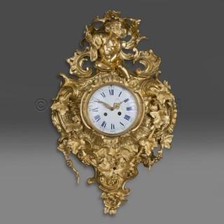 An Elaborate Louis XV Style Gilt-Bronze Cartel Clock