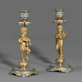 A Pair of Napoléon III Gilt-Bronze and Champlevé  Figural Candlesticks