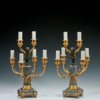 A pair of Napoleon III six-light candelabra