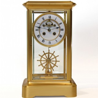 Four Glass Clock with ships wheel pendulum