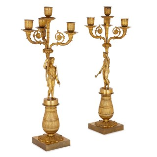 Two early 19th Century French Empire gilt bronze candelabra