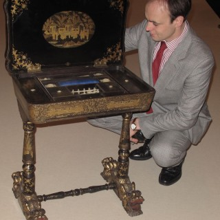 A originally lacquered sewing/work table still with the original gold paint work, Chinese, 19 th. century,