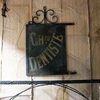A Large 19thC Double Sided Cast Iron French Sign Written Trade Sign; 'Ch.en Dentiste'; c.1890
