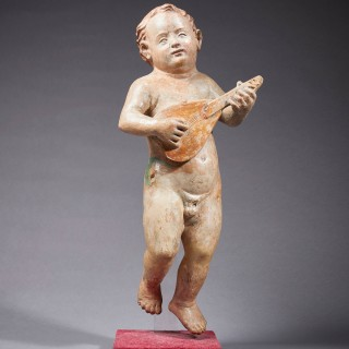 A Renaissance Putto Playing the Lute, Italian, 16th century