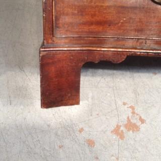 Geo III serpentine mahogany chest of drawers.