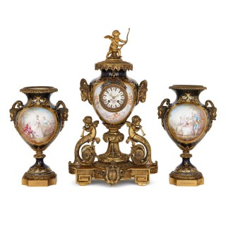 Rococo style gilt bronze and Sevres style porcelain clock garniture