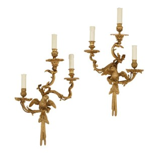 Pair of Rococo style three-light wall brackets, after Charles Cressent