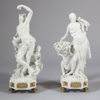 PAIR OF FRENCH 19TH CENTURY BISCUIT PORCELAIN FIGURINES OF BACCHUS AND CERES