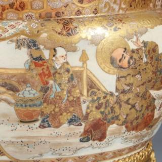 A JAPANESE MEIJI PERIOD ORMOLU MOUNTED SATSUMA PORCELAIN JARDINIERE