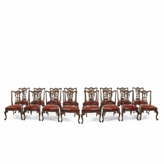 Set of 16 Victorian mahogany dining chairs in the Chippendale style (England, c. 1890)